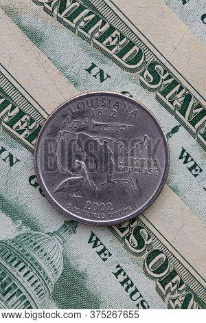 A Quarter Of Louisiana On Us Dollar Bills. Symmetric Composition Of Us Dollar Bills And A Quarter Of