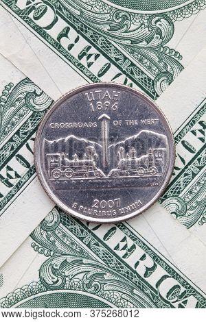 A Quarter Of Utah On Us Dollar Bills. Symmetric Composition Of Us Dollar Bills And A Quarter Of Utah