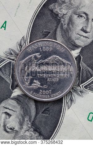 A Quarter Of Washington  On Us Dollar Bills. Symmetric Composition Of Us Dollar Bills And A Quarter
