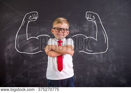 Child With Confidence Ready To Defense From Bullying. School Boy In Uniform And Glasses. Kid Showing