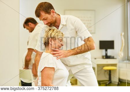 Competent chiropractor treats a patient's back pain in physiotherapy
