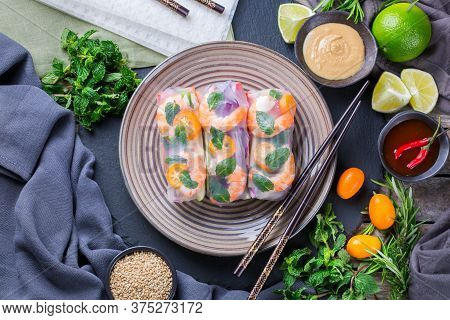Spring Or Summer Rolls With Rice Paper, Carrot, Chili Sauce, Red Cabbage, Zucchini , Pepper, Shrimps