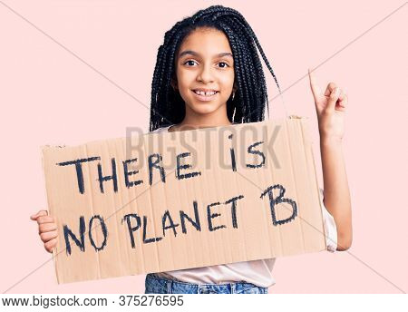 Cute african american girl holding there is no planet b banner surprised with an idea or question pointing finger with happy face, number one