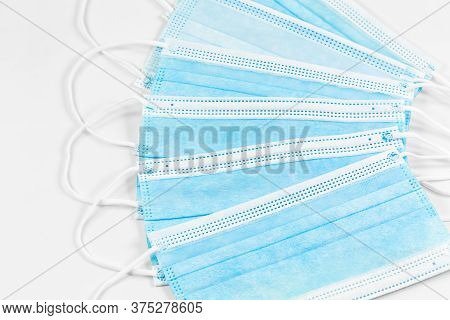 Some Surgical Masks Isolated On White Background