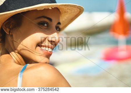 Close-up Portrait Summer Woman In Straw Hat