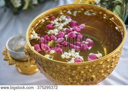 Water In Water Dipper With Colorful Flowers Pedestal For Songkran Festival, Thailand