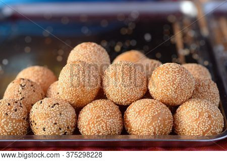 Sesame Seed Balls  Is A Famous Thai Desserts. A Golden Brown Shell Of Sesame Studded Rice Flour That