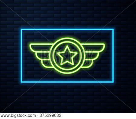 Glowing Neon Line Star American Military Icon Isolated On Brick Wall Background. Military Badges. Ar