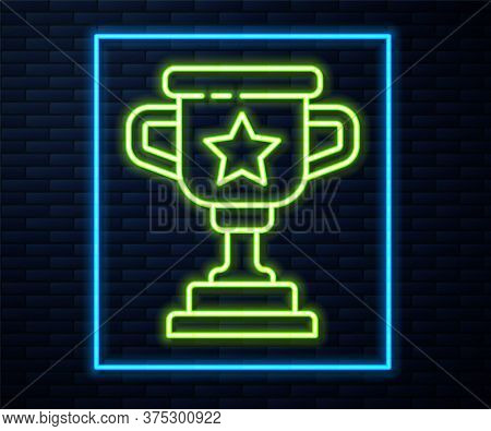 Glowing Neon Line Award Cup Icon Isolated On Brick Wall Background. Winner Trophy Symbol. Championsh