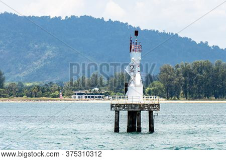An Active Pile Beacon Located In The Sea In Front Ot The Beach In Phang Nga, Southern Of Thailand.