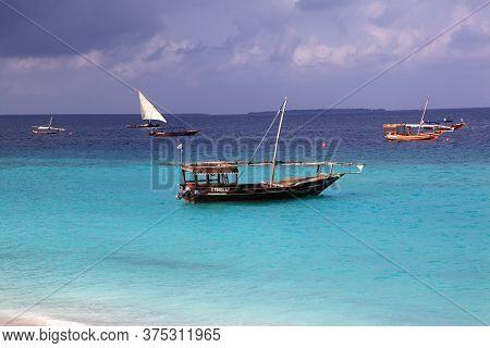 Zanzibar / Tanzania - 01 Jan 2017: Boats On Nungwi Beach Of Zanzibar, Tanzania