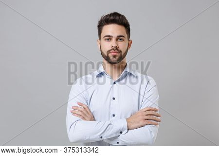 Handsome Confident Young Unshaven Business Man In Light Shirt Posing Isolated On Grey Background Stu