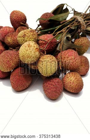 Cluster Of Fresh Lychee Or Litchi With Selective Focus Isolated On White Background