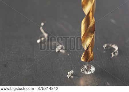 Metal Drill Bit Make Holes In Steel Billet On Industrial Drilling Machine With Shavings. Metal Work