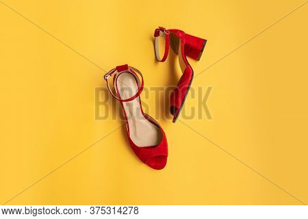 Red Female Shoes On A Yellow Background. Flat Lay, Top View. Beauty Blog Concept.