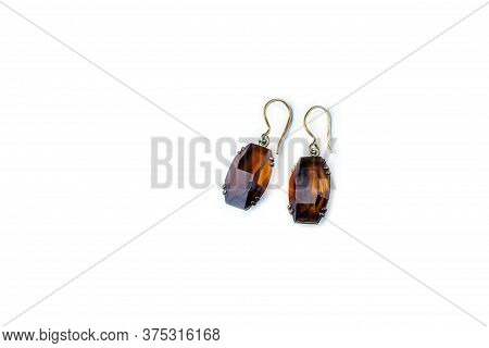 Vintage Antique Earrings, Eardrop From Citrine On White Background. Oldfashioned Decoration From Gra