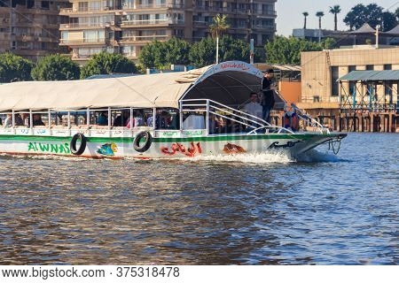 Cairo, Egypt - December 8, 2018: Pleasure Boat On Sailing Down The Nile River In Cairo, Egypt