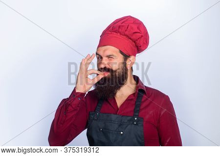 Bearded Male Cook With Taste Approval Gesture. Professional Chef Man Showing Sign For Delicious. Win