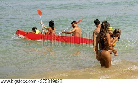 Cairu, Bahia / Brazil - November 14, 2013: Tourists Enjoy The Beauty Of Terceira Beach In Morro De S