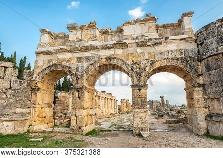 Facade of Domitian gates in antique city Hierapolis, Pamukkale, Turkey. Ruins of the ancient city of Hierapolis in Denizli, Turkey