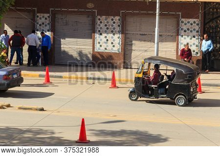 Cairo, Egypt - December 8, 2018: Tuk Tuk (auto Rickshaw) Taxi On A Street Of Cairo
