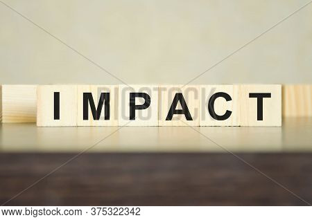 Text Influence Written On Cubes And Dark Background. Environmental Impact. The Influence Of Money
