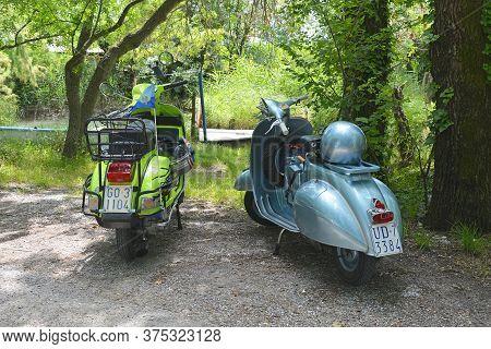 Villaggio Di Punta Sdobba, Italy - June 14 2020. Two Vespas, Part Of A Small Rally Of Vespa Motorike