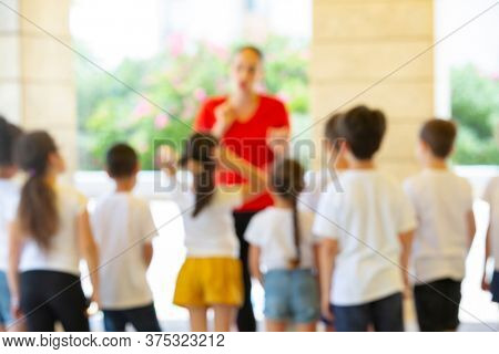 Kids with Teacher Outside of School, Blur Image For background usage,  Israel