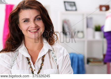 Beautiful Smile Fashion Industry Woman Worker. Lifes Work Brings Happiness To Girl Cutter. Pleasant