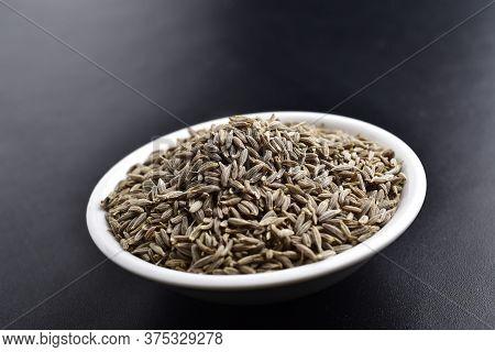 Cumin Jeera Seeds , Indian Spices, Ceramic Bowl On Black Background, Cumn Seeds Close Up