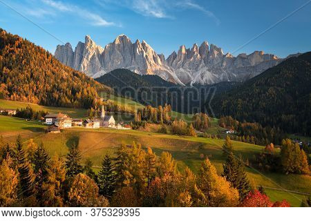 Church In The Tiny Village Sankt Magdalena In Villnoess In An Autumn Landscape With Yellow Larch Tre