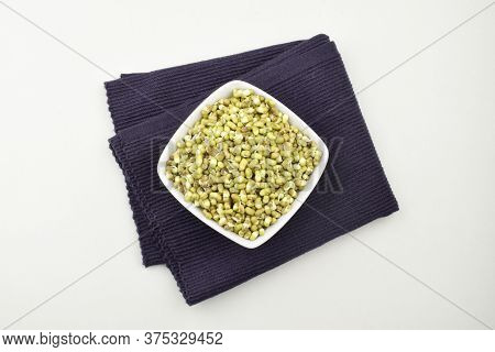 Mung Bean Sprouts In White Bowl On Place Mat Isolated On White Background, Top View Of Mung Sprouts