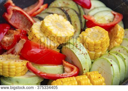 Fresh Chopped Vegetables With Spices For Grilling, Pieces Of Ripe Corn, Pepper, Zucchini