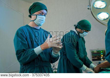 Surgery Team In The Operating Room,ready To Work On A Patient,medical Worker In Surgical Uniform In
