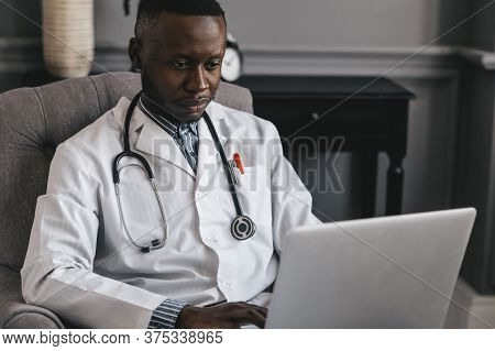 Telehealth With Virtual Doctor Appointment And Online Therapy Session. Black Doctor Online Conferenc