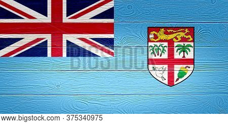 Fiji Flag Painted On Old Wood Plank Background. Brushed Wooden Board Texture. Wooden Texture Backgro