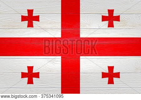 Georgia Flag Painted On Old Wood Plank Background. Brushed Wooden Board Texture. Wooden Texture Back
