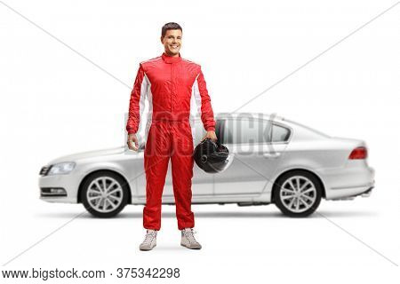 Full length portrait of a car racer posing in front of a silver car isolated on white background