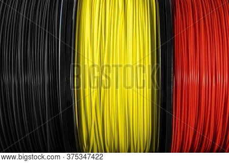 Belguim Flag Of The Coils For 3d Printer. Filament For 3d Printing, Bright Thermoplastic Of Black, Y