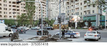 Baku, Azerbaijan - May 2, 2019: Police Surveilling Central Baku Street With Cars Apartment Buildings
