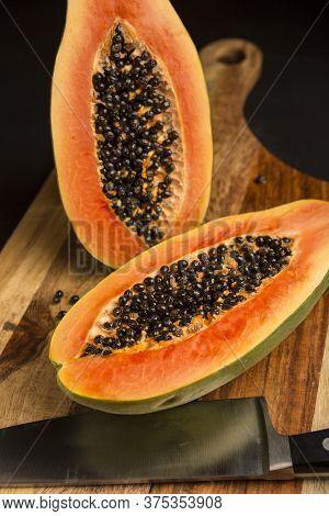 Papaya Fresh Cut With A Knife On Wood Background. Sliced Papaya. Ripe Papaya