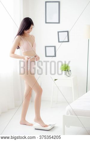 Beautiful Young Asian Woman Sexy Body Slim Standing On Scales Measuring Abdomen For Control Weight L