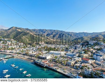 Aerial View Of Avalon Harbor In Santa Catalina Island With Sailboats, Fishing Boats And Yachts Moore