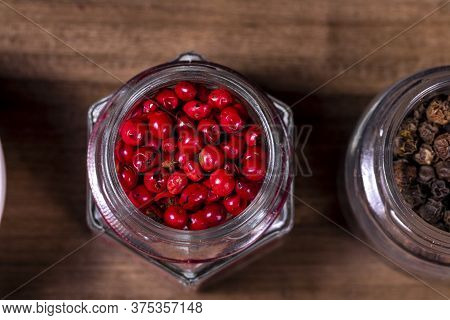 Glass Jars With Black And Red Peppercorns