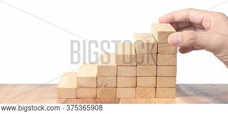 Hand Holds Wooden Blocks On White Background