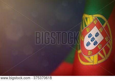 Portugal Hanging Flag For Honour Of Veterans Day Or Memorial Day On Blue Dark Velvet Background. Por