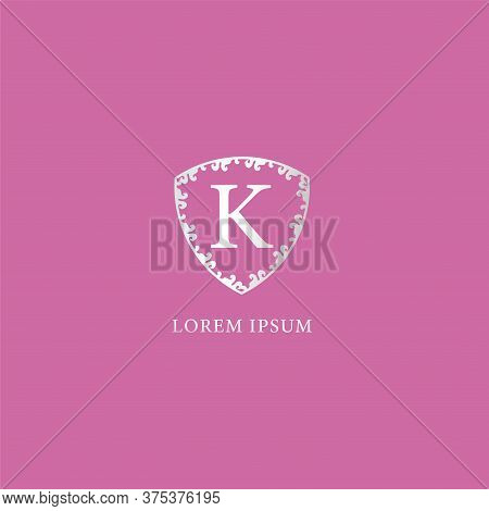 K Letter Intial Logo Design Template. Isolated On Pink Color Background. Luxury Silver Decorative Fl