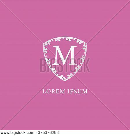 M Letter Intial Logo Design Template. Luxury Silver Decorative Floral Shield Illustration. Suitable