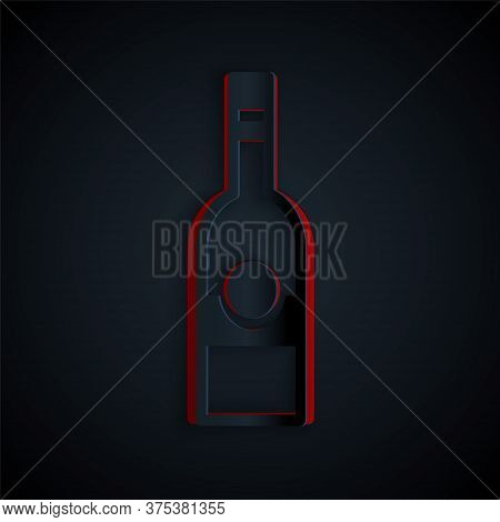 Paper Cut Glass Bottle Of Vodka Icon Isolated On Black Background. Paper Art Style. Vector