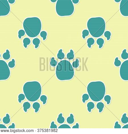 Green Paw Print Icon Isolated Seamless Pattern On Yellow Background. Dog Or Cat Paw Print. Animal Tr